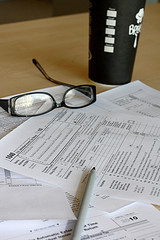 Papers, pen and eye glasses