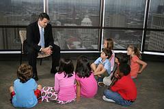 Lawyer talking to 6 children